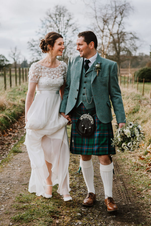 Married Couple Walking Hand in Hand at Ballathie House Hotel
