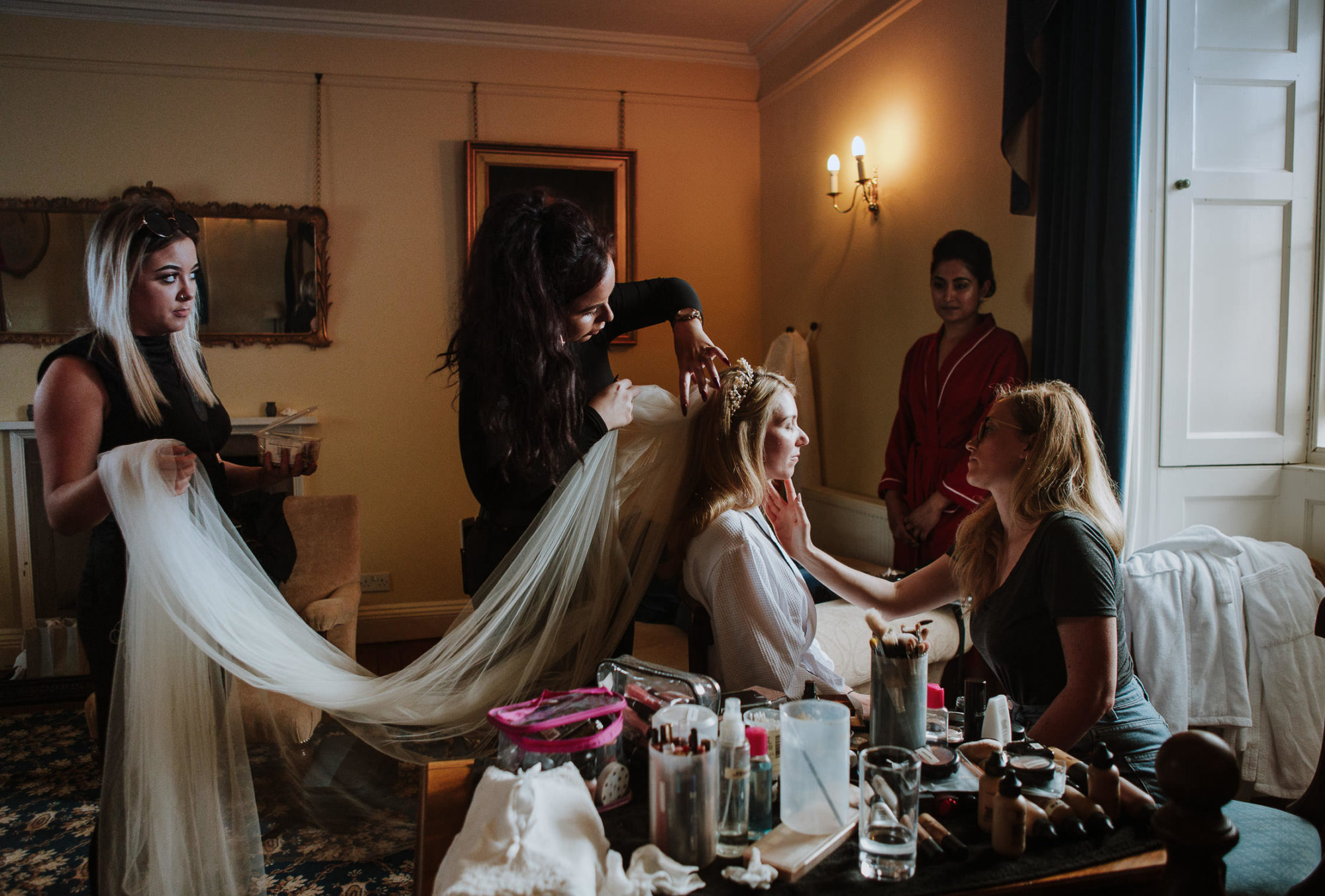 Bride getting hair and make up at the same time