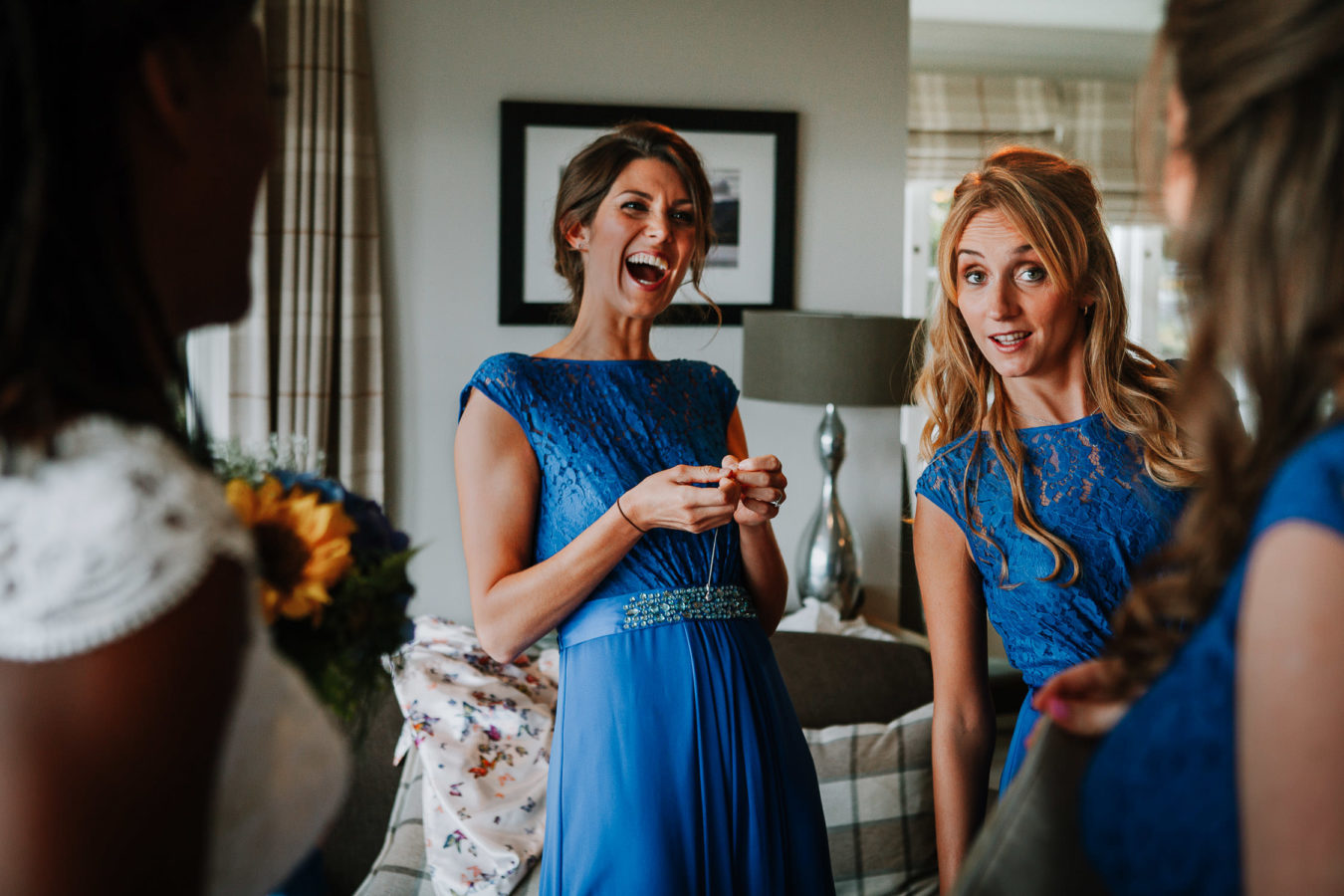 Bridesmaids in blue dresses laughing at Creiff Hydro