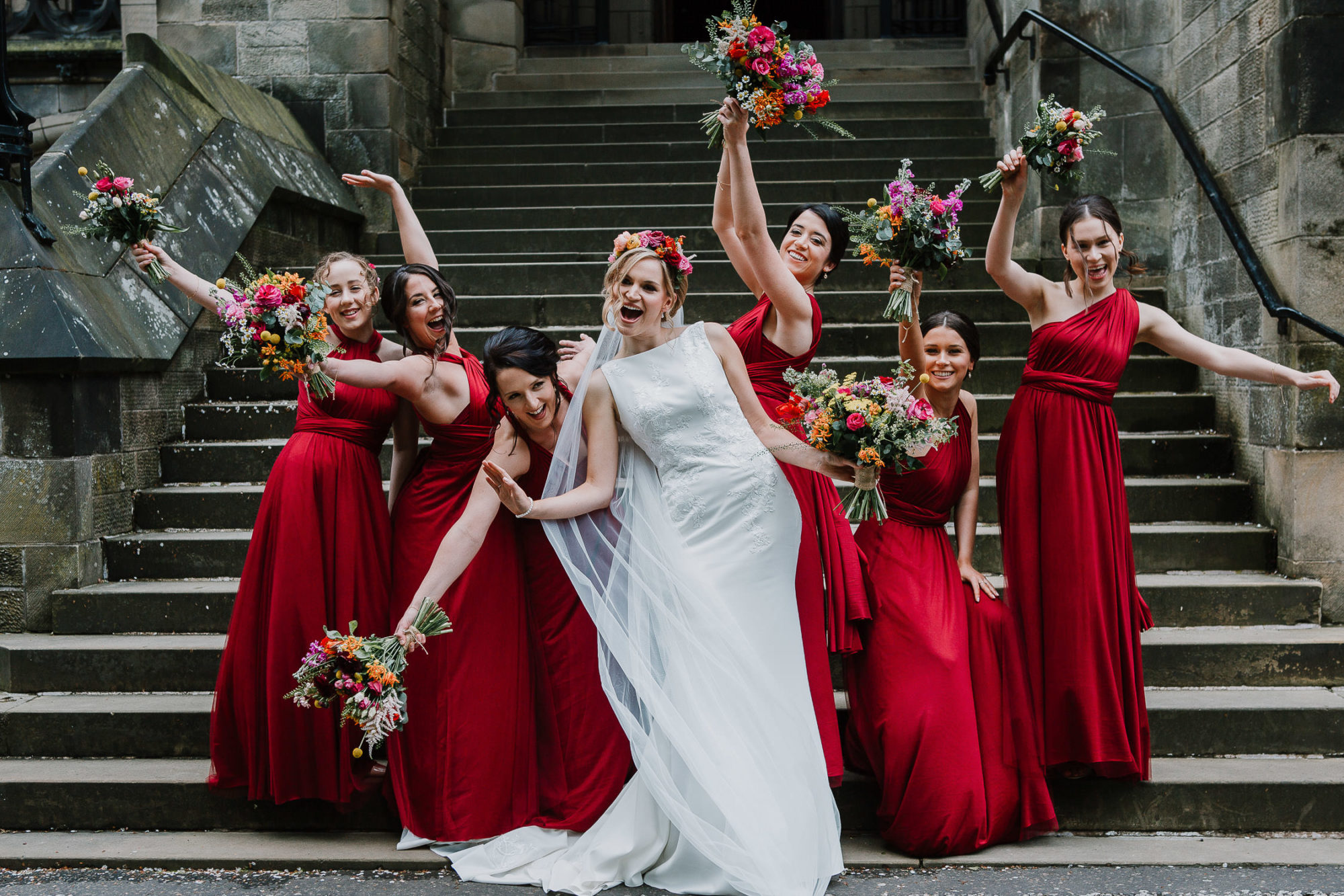 Bride and her bridesmaids striking a pose
